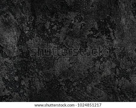 Natural black volcanic seamless stone texture background pattern. Charcoil texture