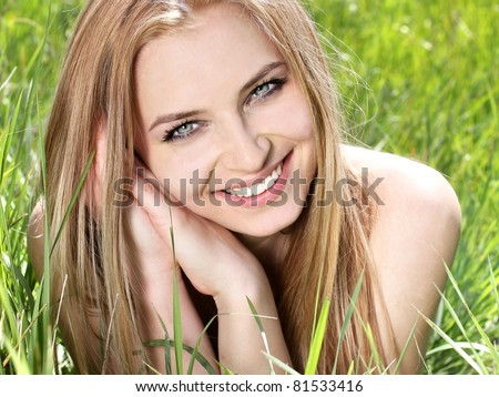 Natural blonde young woman with happy smile, teeth