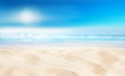 Natural blurred defocused background for concept summer vacation. Nature of tropical summer beach with sun in haze. Light sand beach, ocean water sparkles against blue sky.