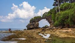 Natural bridge rock formation at Neil island beach Andaman India.