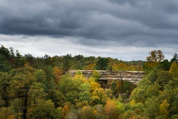 Natural Bridge State Park during autumn with a cloudy sky