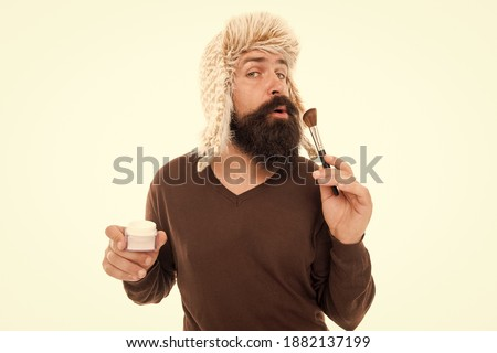 Natural brush. Stylist career. Freak visagiste. Applying makeup face tone. Powder cosmetics. Man bearded stylist wear hat hold brush for makeup. Eccentric guy with beard. Makeup and greasepaint. Foto stock ©
