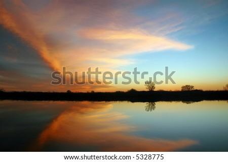 Natural Butterfly Shaped Sunset Reflection over Leafless Trees, San Joaquin Delta, California