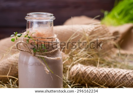 Natural chocolate milkshake is in the hay.
