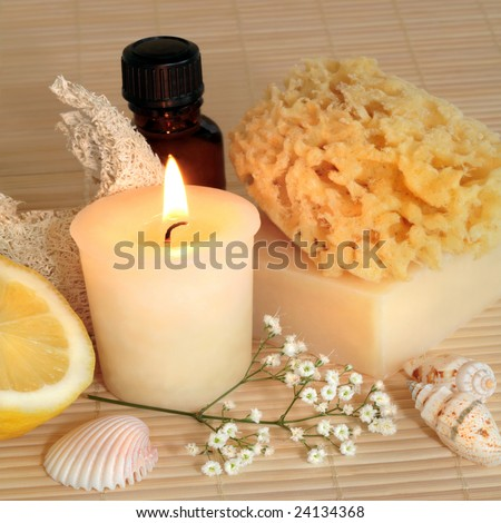 Natural cleansing products lit by a candle, set against a bamboo background.