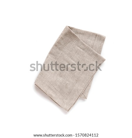 Natural cloth kitchen napkin, linen tablecloth isolated on white background, top view, design element.