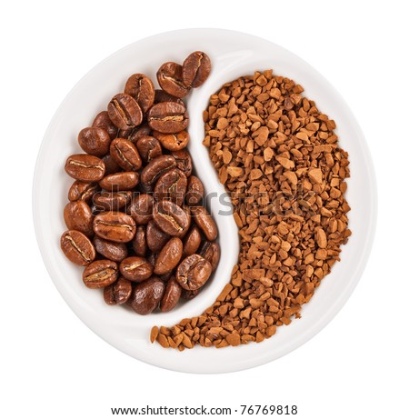 Natural coffee beans versus instant one in Yin Yang shaped plate, isolated on white