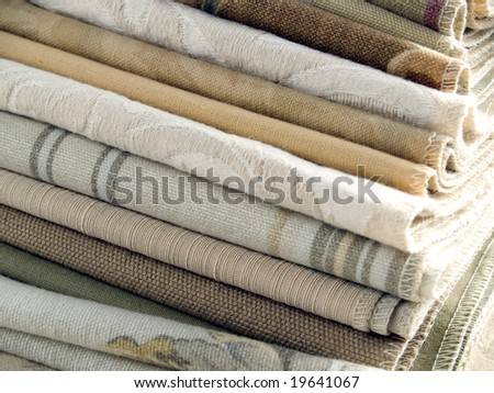 Natural color fabric swatches with plain, striped and floral patterns