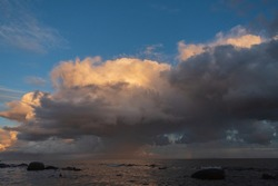 natural color of beautiful rain clouds over the sea coast, a sea storm coming to the shore.