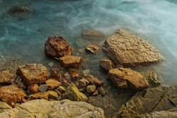 Natural Colorful long exposure detail of rocks and sea in tropical ocean, background or wallpeper