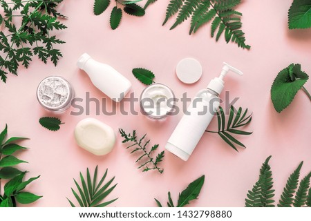 Natural cosmetics and green leaves on pink background, top view, flat lay. Natural organic skincare, bio research and healthy lifestyle concept. #1432798880