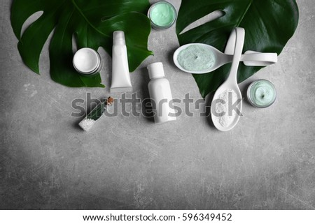 Natural cosmetics and leaves on grey background #596349452
