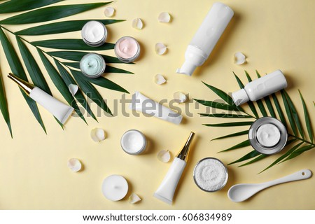 Natural cosmetics and leaves on light background #606834989