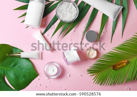 Natural cosmetics and leaves on pink background #590528576