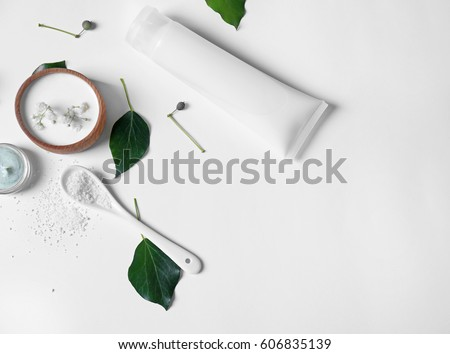 Natural cosmetics and leaves on white background #606835139