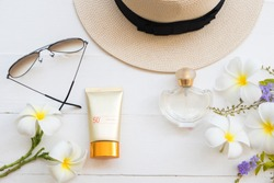 natural cosmetics for skin face sunscreen spf50 with accessories  of lifestyle woman relax summer on background white  flat lay style