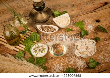Natural cosmetics ingredients displayed on a rustic table