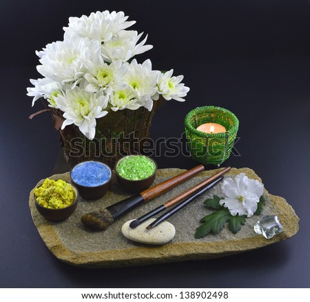 Natural cosmetics set with candle and flowers