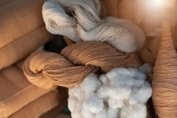 Natural cotton yarn. In rolls. Brown cotton fibers.Natural fibers to protect the environment.