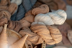 Natural cotton yarn. In rolls. Brown cotton fibers. Natural fibers to protect the environment.