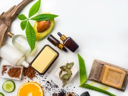 Natural eco skin care products, top view ingredients. Cosmetic, masks, soap, leaf, aloe vera, avocado, serum, hyaluronic acid, coconut milk. Facial treatment preparation background.