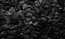 Natural fire ashes with dark grey black coals texture. It is a flammable black hard rock.  Space for text.