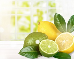 Natural fresh lime and lemons with green leaves