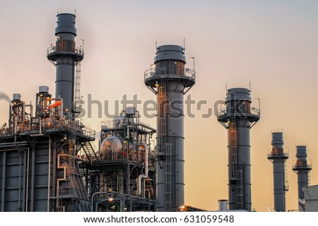Natural Gas Combined Cycle Power Plant with sunset #631059548