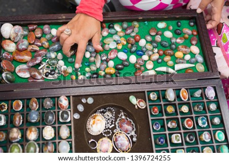 Natural gem stones, pieces of raw polished gems and jewelry different colors #1396724255