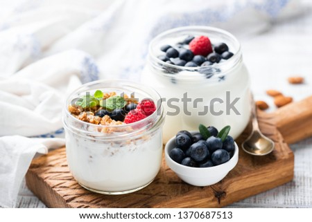 Natural Greek Yogurt With Fresh Berries And Granola In Jar. Healthy Eating, Healthy Lifestyle, Sporty Fitness Food Menu Concept