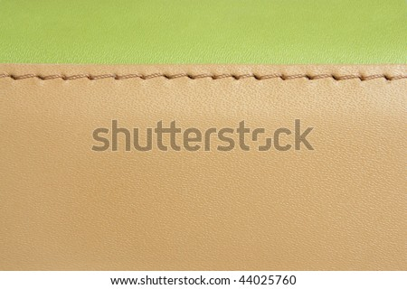 Natural green and brown leather background closeup