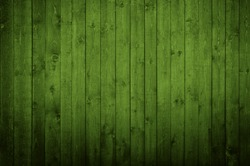 Natural green wood texture with an array of knots and ring lines.