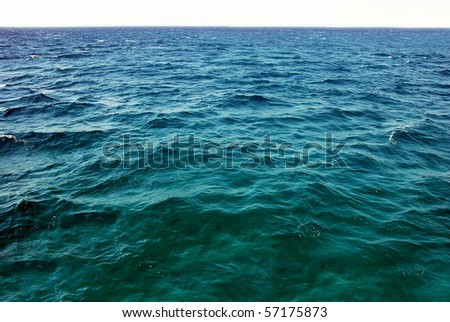 natural greenish seawater surface - stock photo