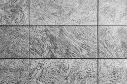 Natural grey granite texture tile wall, gray travertine marble, rock surface background. Grunge abstract backdrop. Stone concrete pattern