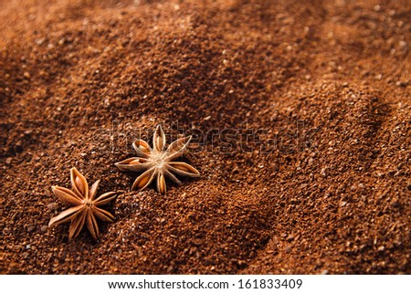 Natural ground coffee background with star anise and some spilled sugar