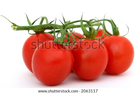 Natural healthy organic pepper tomatoes on green stalks, over white, macro closeup on white with copy space