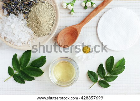 Shutterstock Natural herbal skin care products, top view ingredients. Cosmetic oil, clay, sea salt, herbs, plant leaves. Facial treatment preparation background.