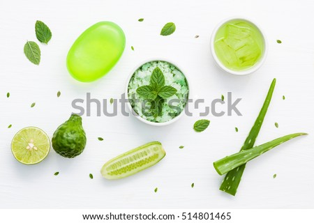 Natural herbal skin care products, top view ingredients. Cosmetic, soap, sea salt, herbs, mint leaf, cucumber, aloe vera,gel. Facial treatment preparation background.