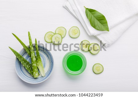 Natural herbal skin care products. Top view ingredients cucumber and aloe vera on table concept of the best all natural face moisturizer. Facial treatment preparation background. #1044223459