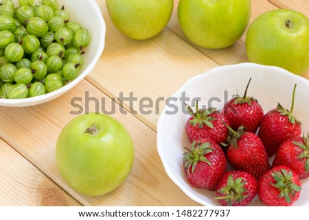 Natural homegrown products background. Top view. Close-up fruits and berries on wooden table.