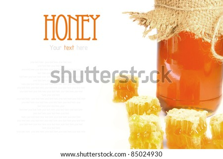 Natural honey in honeycombs. Honey in bank. A place for your text.