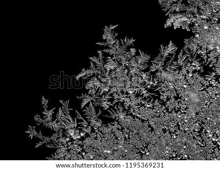 Natural ice crystals frostwork pattern on dark backround. Macro closeup. #1195369231