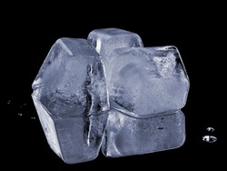 natural ice cubes, isolated on black background with reflection