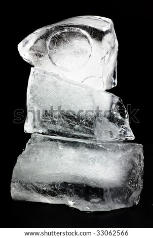 natural ice cubes on black background - stock photo