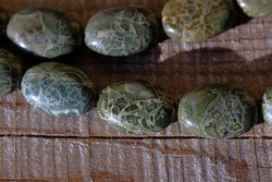 Natural jasper with a pattern similar to snakeskin.