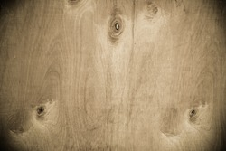 Natural knotted wood texture as background.