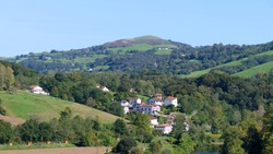 Natural landscape and green valley in cambo-les-bains, french countryside, in a sunny day. South West of France.
