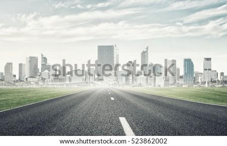 Natural landscape with asphalt road and modern city #523862002