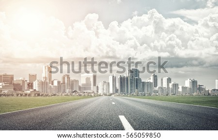 Natural landscape with asphalt road and modern city