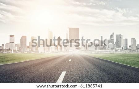 Natural landscape with asphalt road and modern city